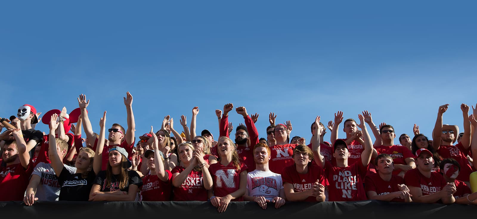 Fans cheer at a Nebraska football game